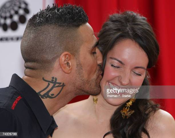 Singer Bushido kisses TV presenter Johanna Klum during 'The Dome 42' music show at the TUI Arena on May 25 2007 in Hanover Germany