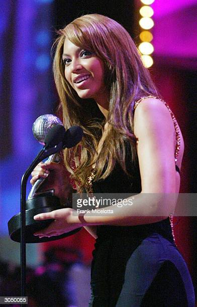 Singer Byonce Knowles accepts her Artist of the Year Award on stage at the 35th Annual NAACP Image Awards held at the Universal Amphitheatre, March...