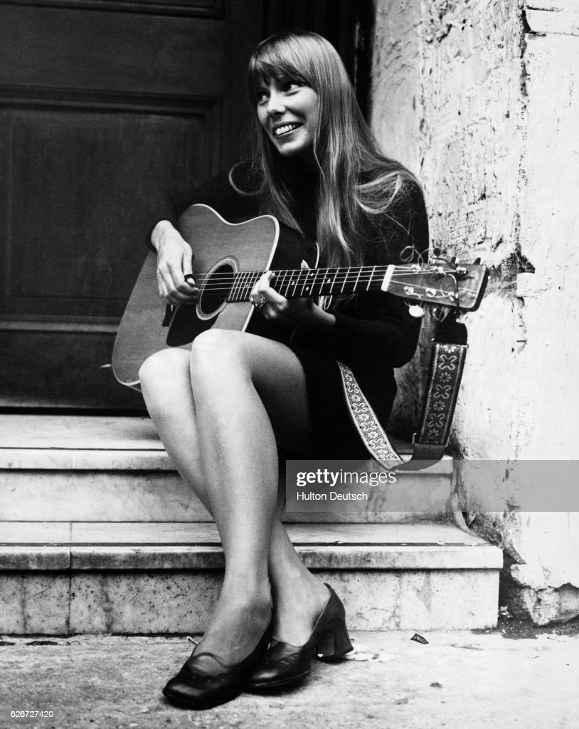 A singer called Joni. Joni Mitchell, Canadian singer-songwriter, United Kingdom, 1968. The guitar-pickin' gal is Joni Mitchell, a long blonde haired Canadian folk singer. Pictured last night outside the Revolution club, Joni is here (until 1st October) for radio, television and concert appearances. Apart from concert appearances, 25 year old Joni will be heard on 'Top Gear' on Radio One and 'The Monday Show' on BBC 1.