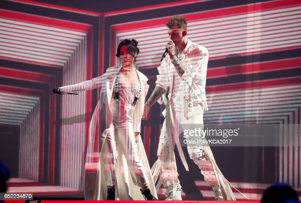 Singer Camila Cabello and rapper Machine Gun Kelly perform onstage at Nickelodeon's 2017 Kids' Choice Awards at USC Galen Center on March 11 2017 in...