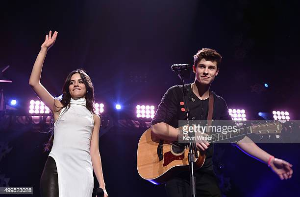 Singer Camila Cabello of Fifth Harmony and Singer/songwriter Shawn Mendes perform onstage during 106.1 KISS FM's Jingle Ball 2015 presented by...
