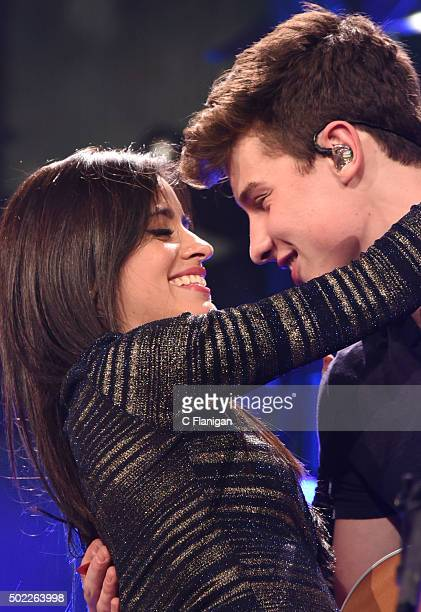 Singer Camila Cabello of Fifth Harmony performs with musician Shawn Mendes onstage during 1035 KISS FM's Jingle Ball 2015 presented by Capital One at...