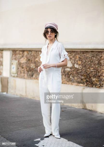 Singer Camila Cabello wearing a white Bluemarine overall Gianvito Rossi pumps pink military hat Ruslan Baginskiy seen on October 16 2017 in Paris...