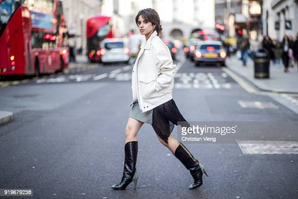 Singer Camila Cabello wearing total look Givenchy including jacket skirt and boots seen during London Fashion Week February 2018 on February 17 2018...