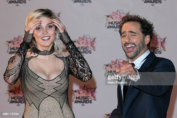 Singer Camille Lou and Florent Peyre attend the 17th NRJ Music Awards ceremony at Palais des Festivals on November 7 2015 in Cannes France