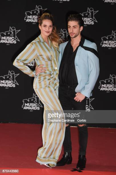 Singer Camille Lou and guest attend the 19th NRJ Music Awards on November 4 2017 in Cannes France