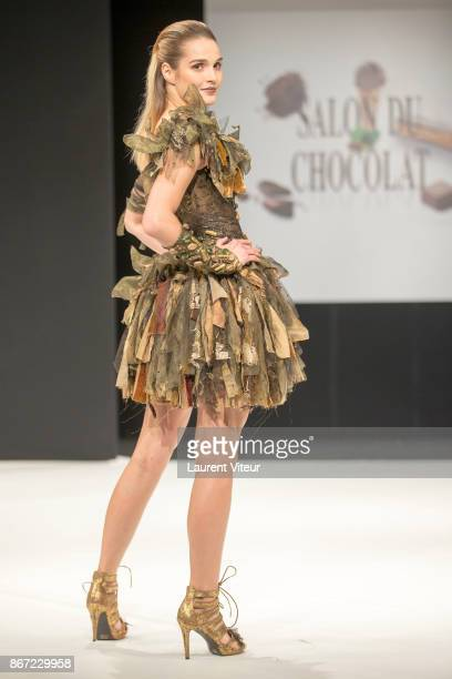 Singer Camille Lou walks the Runway during Le Defile des Robes en Chocolats during the Salon du Chocolat Paris 2017 at Parc des Expositions Porte de...