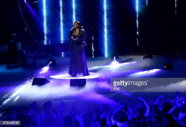 Singer Candice Glover performs onstage at FOX's American Idol XIII Top 13 To 12 Live Elimination Show on February 27 2014 in Hollywood California