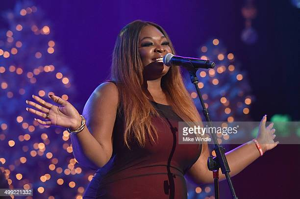 Singer Candice Glover performs onstage during the 2015 Hollywood Christmas Parade on November 29 2015 in Hollywood California