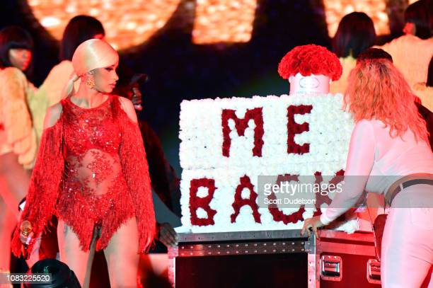 Singer Cardi B is presented a 'Take Me Back' card onstage Offset during day 2 of the Rolling Loud Festival at Banc of California Stadium on December...