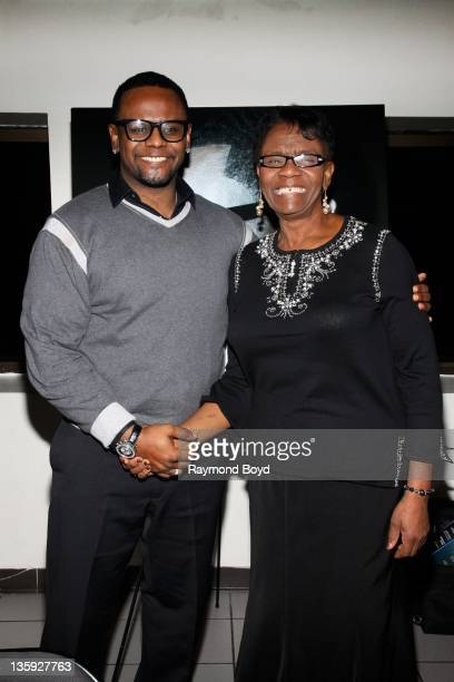 Singer Carl Thomas poses for a photo with his mother Dorothy Thomas during The Experience With Carl Thomas at the DuSable Museum in Chicago Illinois...