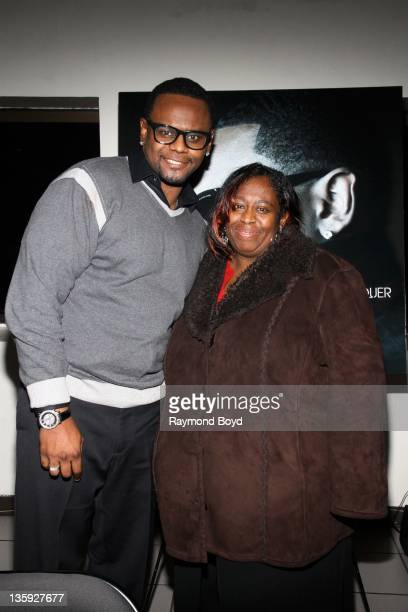Singer Carl Thomas poses for a photo with his sister Gail Evans during The Experience With Carl Thomas at the DuSable Museum in Chicago Illinois on...