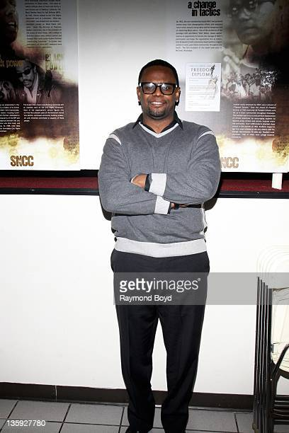 Singer Carl Thomas poses for photos during The Experience With Carl Thomas at the DuSable Museum in Chicago Illinois on DECEMBER 06 2011