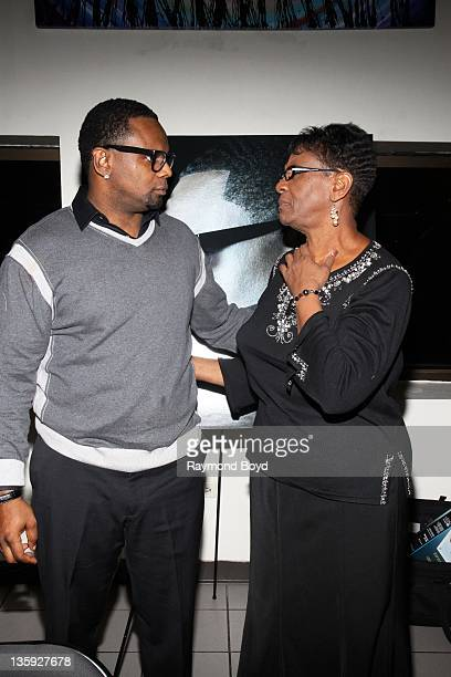Singer Carl Thomas shares a moment with his mother Dorothy Thomas during The Experience With Carl Thomas at the DuSable Museum in Chicago Illinois on...
