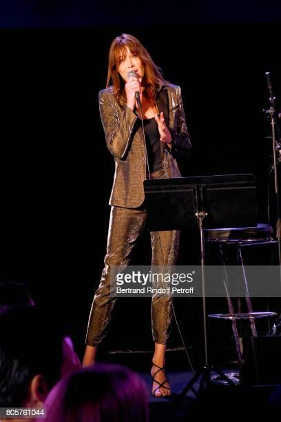Singer Carla Bruni performs during the amfAR Paris Dinner 2017 at Le Petit Palais on July 2 2017 in Paris France