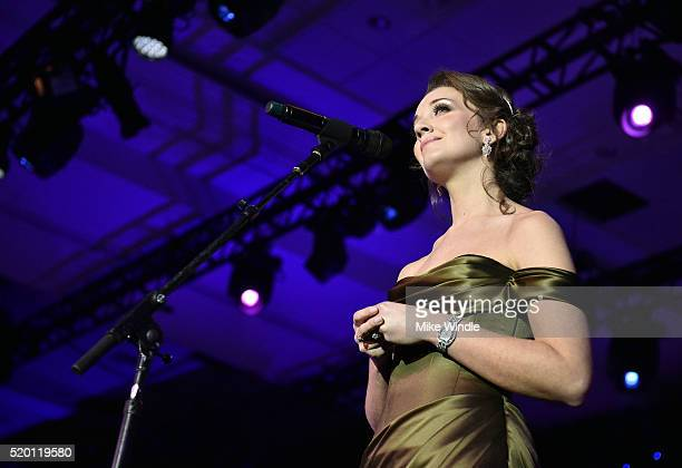 Singer Carly Paoli performs onstage during Muhammad Ali's Celebrity Fight Night XXII at the JW Marriott Phoenix Desert Ridge Resort Spa on April 8...