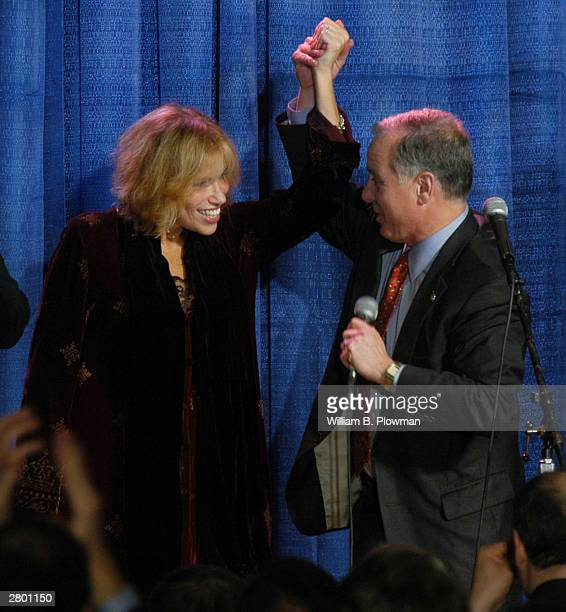 Singer Carly Simon and Democratic frontrunner Howard Dean attend the New England Holiday Gala a fundraiser December 10 2003 in Boston Massachusetts...