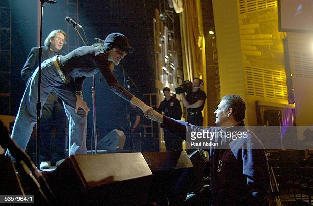 Singer Carly Simon shakes the hand of Brian Wilson at the Tribute to Brian Wilson New York New York March 8 2001