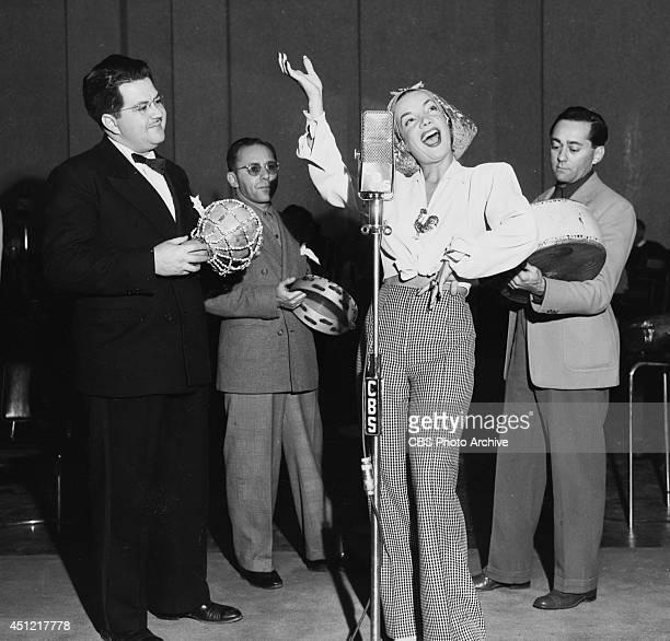 Singer Carmen Miranda performs on the CBS radio program ELGIN CHRISTMAS SHOW on December 25 in Los Angeles California