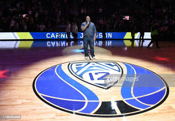 Singer Carnell Johnson performs the American national anthem before the championship game of the Pac12 basketball tournament between the Oregon Ducks...