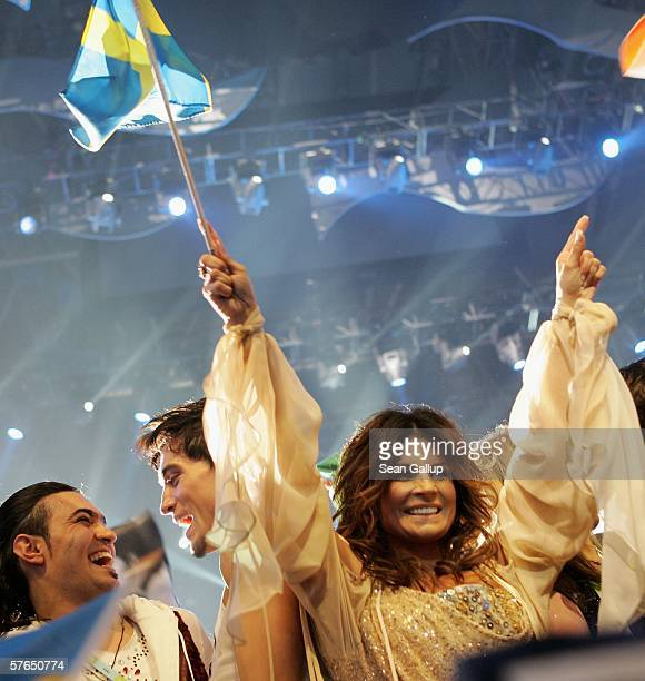 Singer Carola of Sweden celebrates while holding a Swedish flag after she made into the finals after the semifinals of the 2006 Eurovision Song...