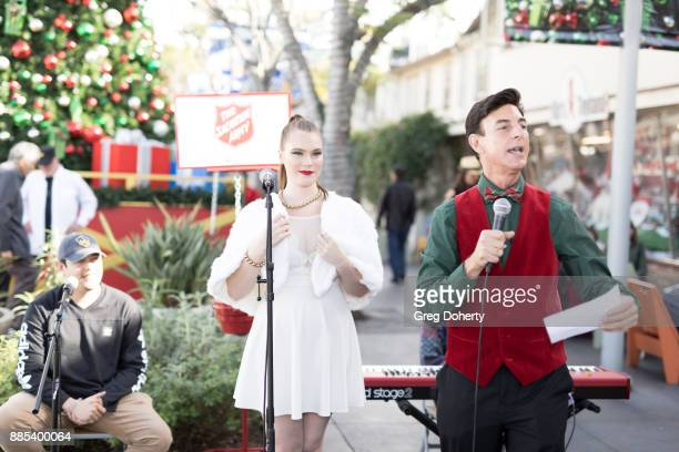 Singer Caroline Roman is introduced by Bj Korros as she performs at The Salvation Army Celebrity Kettle Kickoff Red Kettle Hollywood at the Original...