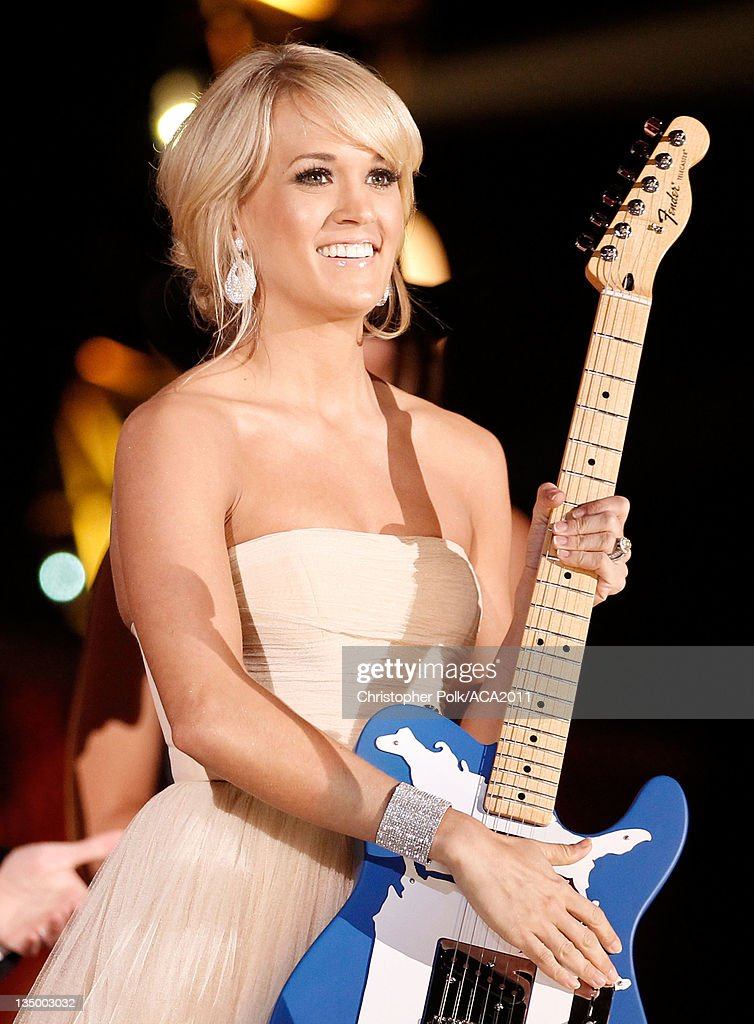 Singer Carrie Underwood accepts the Artist of the Year Award onstage at the American Country Awards 2011 at the MGM Grand Garden Arena on December 5, 2011 in Las Vegas, Nevada.