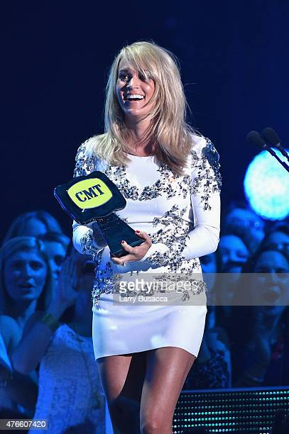 Singer Carrie Underwood accepts the Collaborative Video of the Year Award onstage during the 2015 CMT Music awards at the Bridgestone Arena on June...