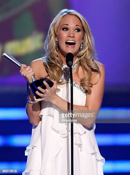 Singer Carrie Underwood accepts the Entertainer of the Year award onstage during the 44th annual Academy Of Country Music Awards held at the MGM...
