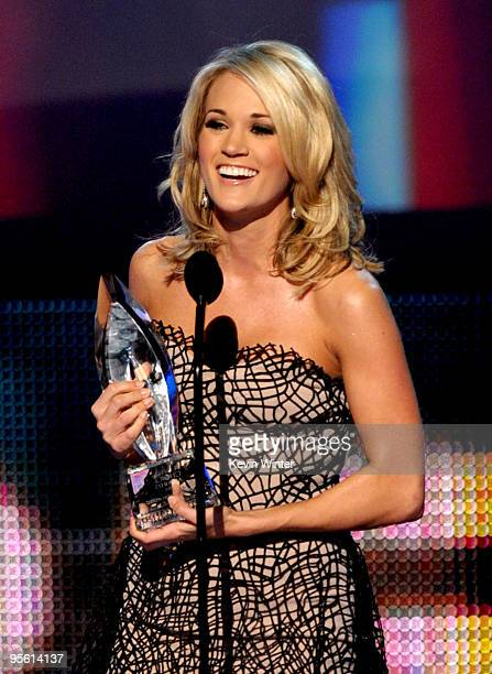 Singer Carrie Underwood accpets the Favorite Country Artist award onstage during the People's Choice Awards 2010 held at Nokia Theatre L.A. Live on...