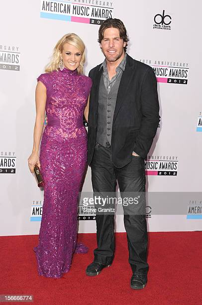 Singer Carrie Underwood and athlete Mike Fisher attend the 40th Anniversary American Music Awards held at Nokia Theatre L.A. Live on November 18,...