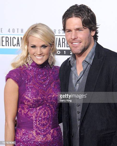 Singer Carrie Underwood and her husband hockey player Mike Fisher arrive at The 40th American Music Awards at Nokia Theatre LA Live on November 18...