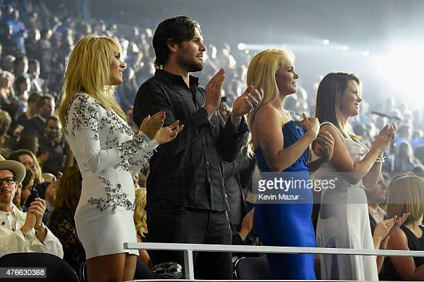 Singer Carrie Underwood and her husband Mike Fisher attend the 2015 CMT Music awards at the Bridgestone Arena on June 10 2015 in Nashville Tennessee