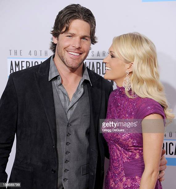 Singer Carrie Underwood and husband Mike Fisher arrive at the 40th Anniversary American Music Awards at Nokia Theatre LA Live on November 18 2012 in...
