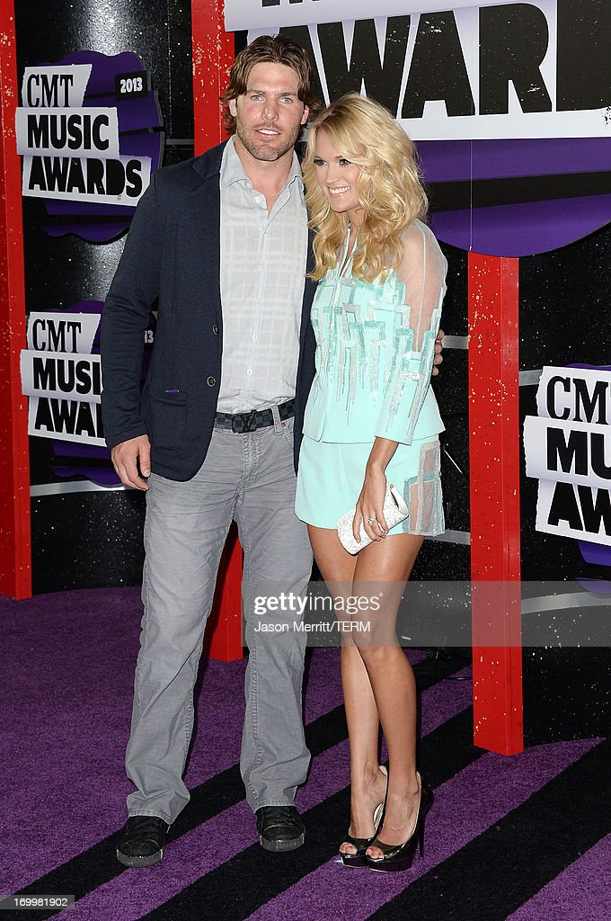 Singer Carrie Underwood (R) and Mike Fisher attend the 2013 CMT Music awards at the Bridgestone Arena on June 5, 2013 in Nashville, Tennessee.