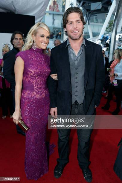 Singer Carrie Underwood and Mike Fisher attend the 40th American Music Awards held at Nokia Theatre LA Live on November 18 2012 in Los Angeles...