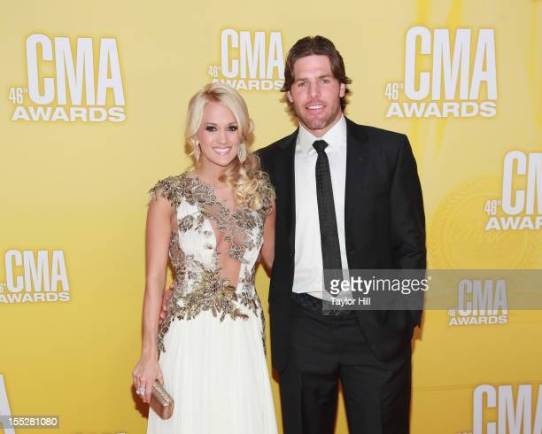 Singer Carrie Underwood and Nashville Predators Centre Mike Fisher attend the 46th annual CMA Awards at the Bridgestone Arena on November 1 2012 in...
