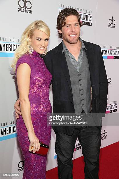 Singer Carrie Underwood and NHL player Mike Fisher attend the 40th American Music Awards held at Nokia Theatre LA Live on November 18 2012 in Los...