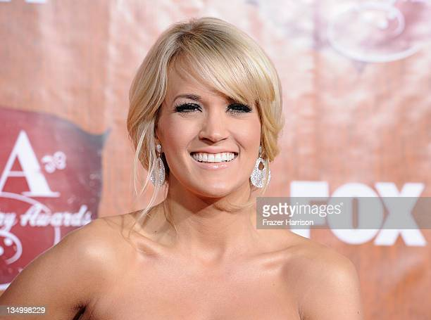 Singer Carrie Underwood arrives at 2011 American Country Awards at MGM Grand Garden Arena on December 5 2011 in Las Vegas Nevada
