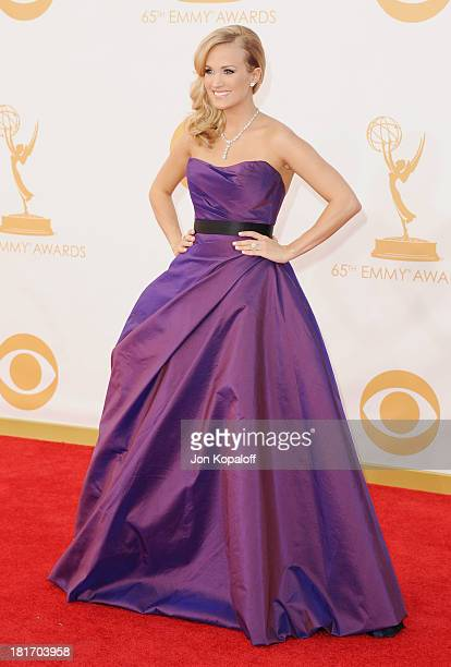 Singer Carrie Underwood arrives at the 65th Annual Primetime Emmy Awards at Nokia Theatre LA Live on September 22 2013 in Los Angeles California