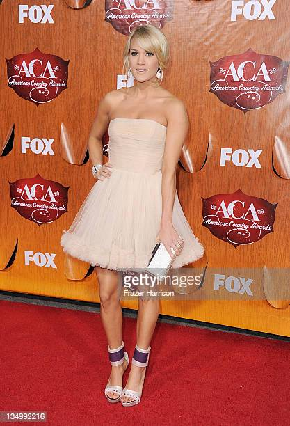 Singer Carrie Underwood arrives at the American Country Awards 2011 at the MGM Grand Garden Arena on December 5 2011 in Las Vegas Nevada