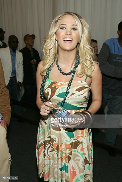 Singer Carrie Underwood holds a bottle of Aquafina water during The Baby Phat Fashion show at Olympus Fashion Week Fall 2006 February 3 2006 in New...