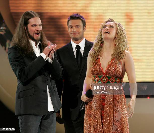 Singer Carrie Underwood is named the new American Idol by host Ryan Seacrest as American Idol finalist Bo Bice looks on during the American Idol...
