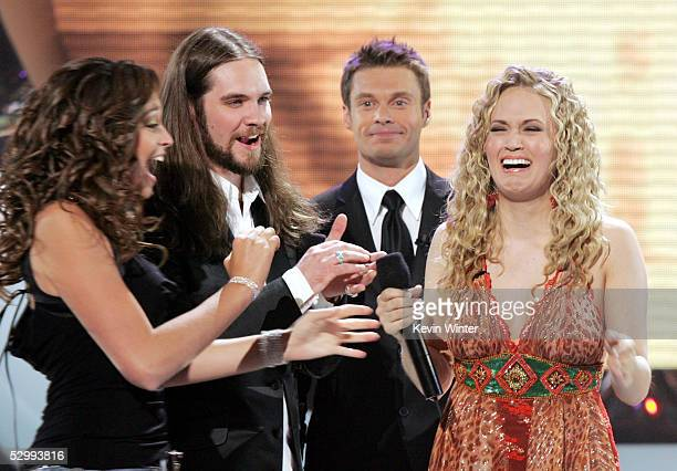 Singer Carrie Underwood is named the new American Idol by host Ryan Seacrest as American Idol finalist Bo Bice and friend look on during Singer...