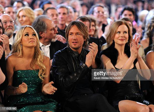 Singer Carrie Underwood musician Keith Urban and actress Nicole Kidman in the audience at the 46th Annual Academy Of Country Music Awards held at the...