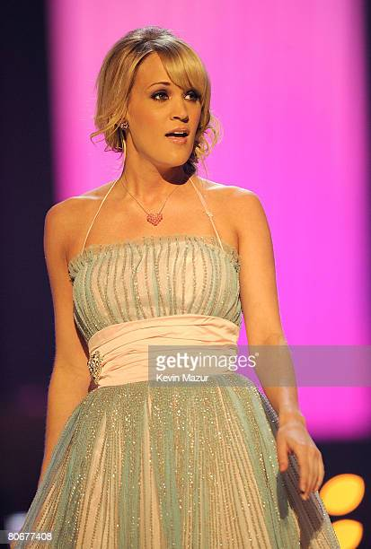 "Singer Carrie Underwood performs ""All-American Girl"" onstage during the 2008 CMT Music Awards at the Curb Event Center at Belmont University on April..."