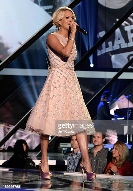 Singer Carrie Underwood performs onstage at the 2013 CMT Music Awards at the Bridgestone Arena on June 5 2013 in Nashville Tennessee
