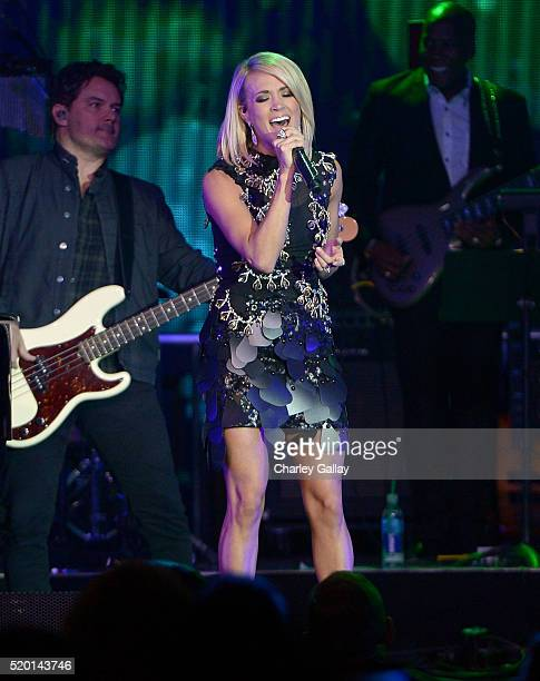 Singer Carrie Underwood performs onstage during Muhammad Ali's Celebrity Fight Night XXII at the JW Marriott Phoenix Desert Ridge Resort Spa on April...