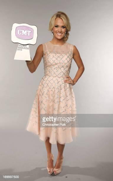 Singer Carrie Underwood poses at the Wonderwall portrait studio during the 2013 CMT Music Awards at Bridgestone Arena on June 5 2013 in Nashville...