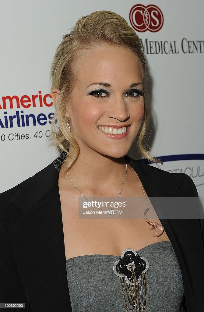 Singer Carrie Underwood poses backstage at the 25th Anniversary Of Cedars-Sinai Sports Spectacular held at the Hyatt Regency Century Plaza Hotel on May 23, 2010 in Los Angeles, California.